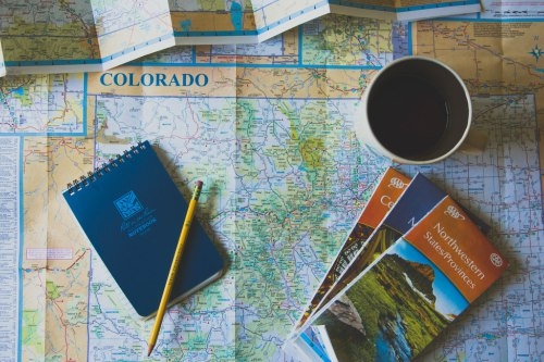 Maps, notebook and coffee.
